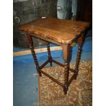 An Oak occasional Table having a shaped top and twist legs, 20'' x 13'' x 28'' high.