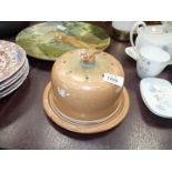 A Studio Pottery cheese dome with finial of mouse eating cheese.