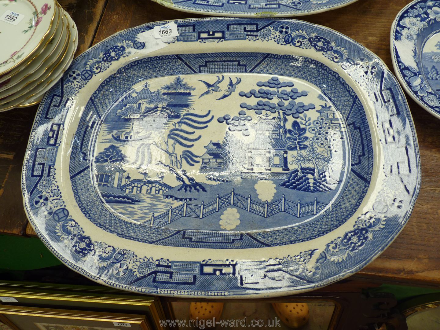 A large Staffordshire blue and white pattern Meat Plate, 21'' x 17'' (with hairline crack).