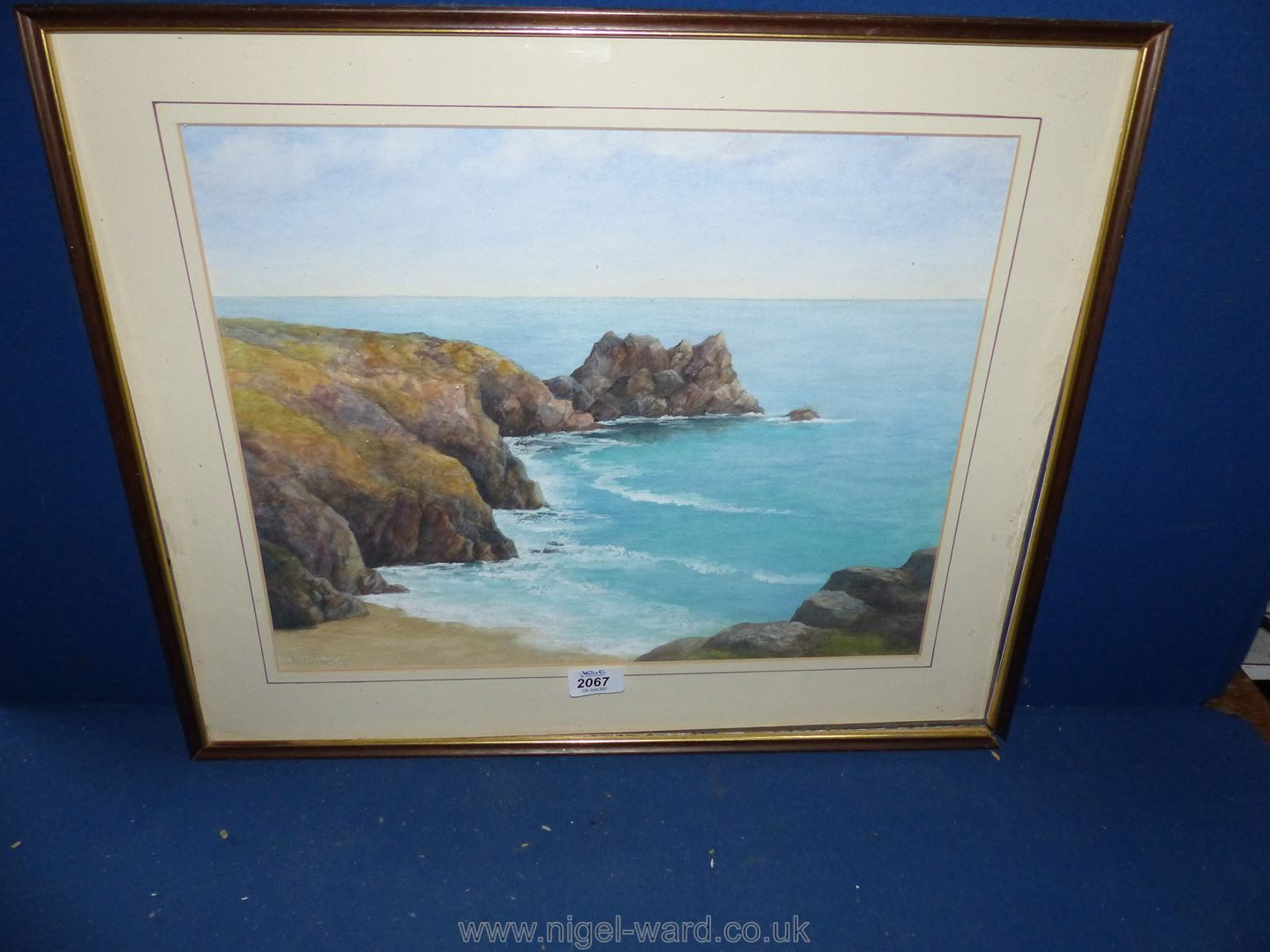 A framed and mounted Oil painting of coastal scene, signed lower right Betty Cowls,