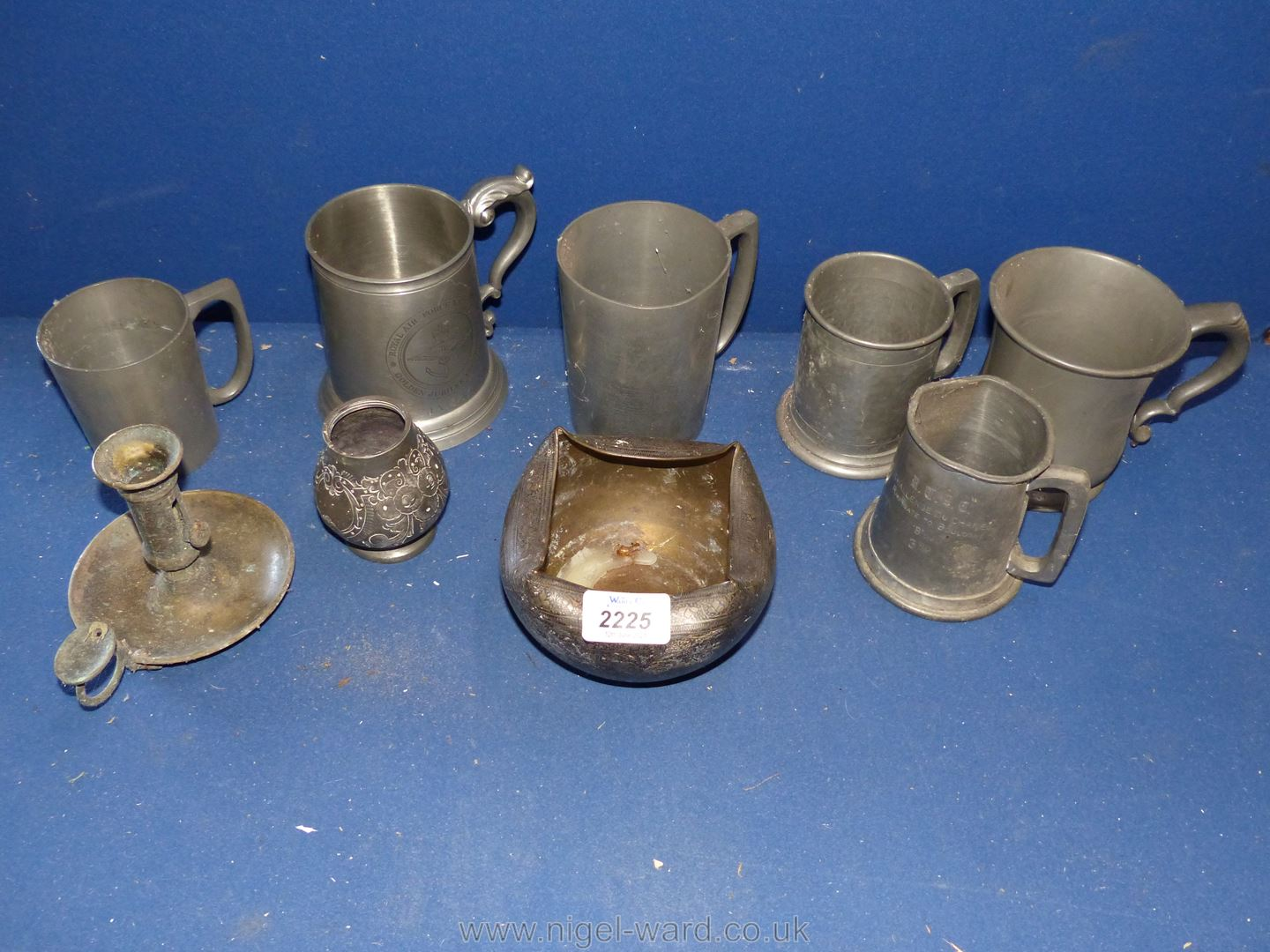 A quantity of Pewter tankards, candlestick and pot.