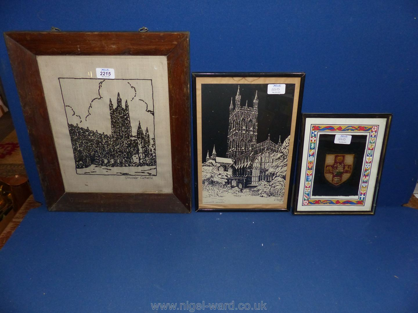 A framed woolwork and a woodblock print,