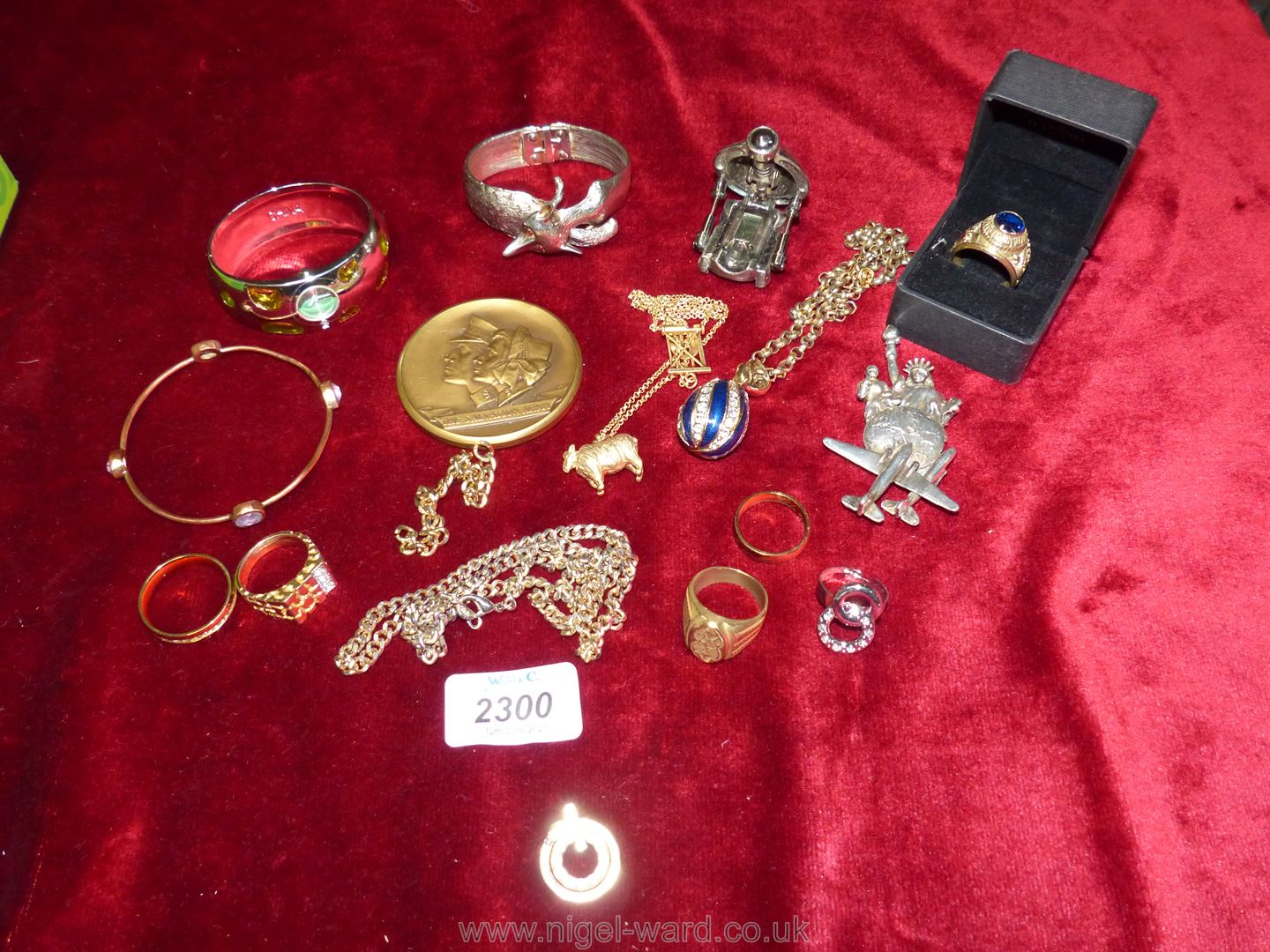 A quantity of costume jewellery including bangles, white metal brooch, large rings,