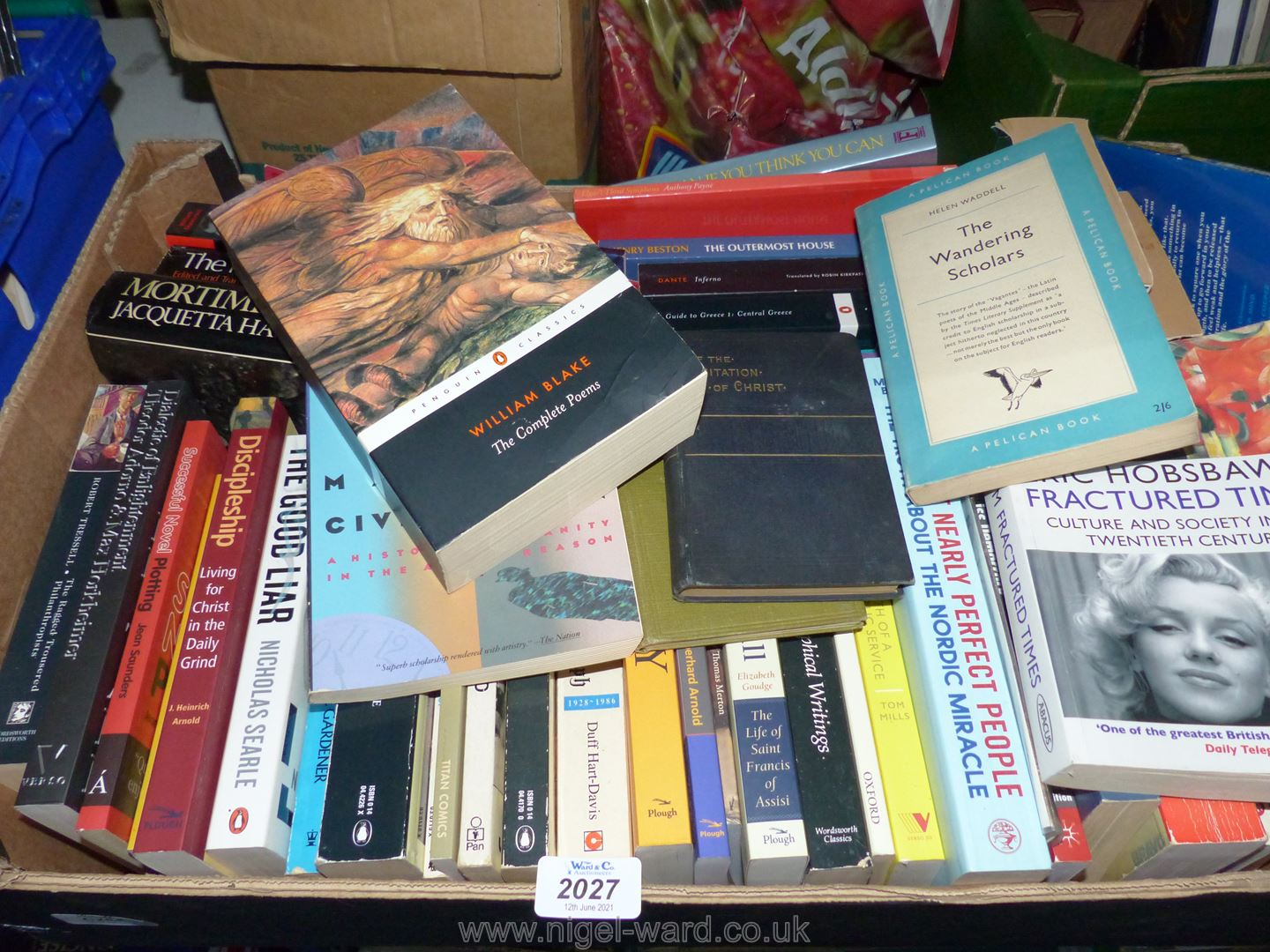 A box of books including How to change the World, Guardians of Power, The Good Liar, etc.