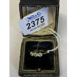 A good Gold three Diamond engagement Ring with platinum setting,