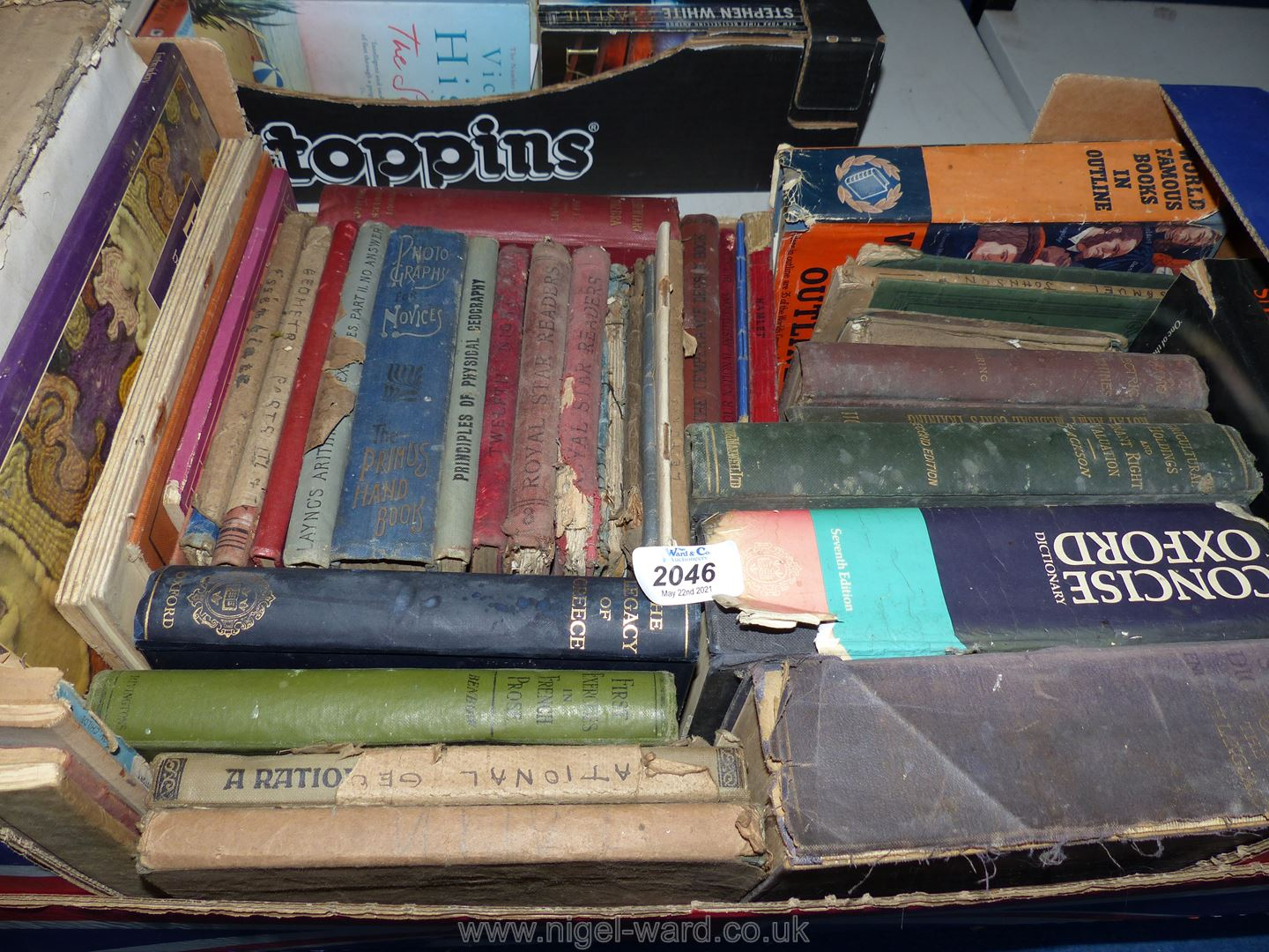 A box of vintage educational books including Thesaurus, dictionaries, Electric machines etc.
