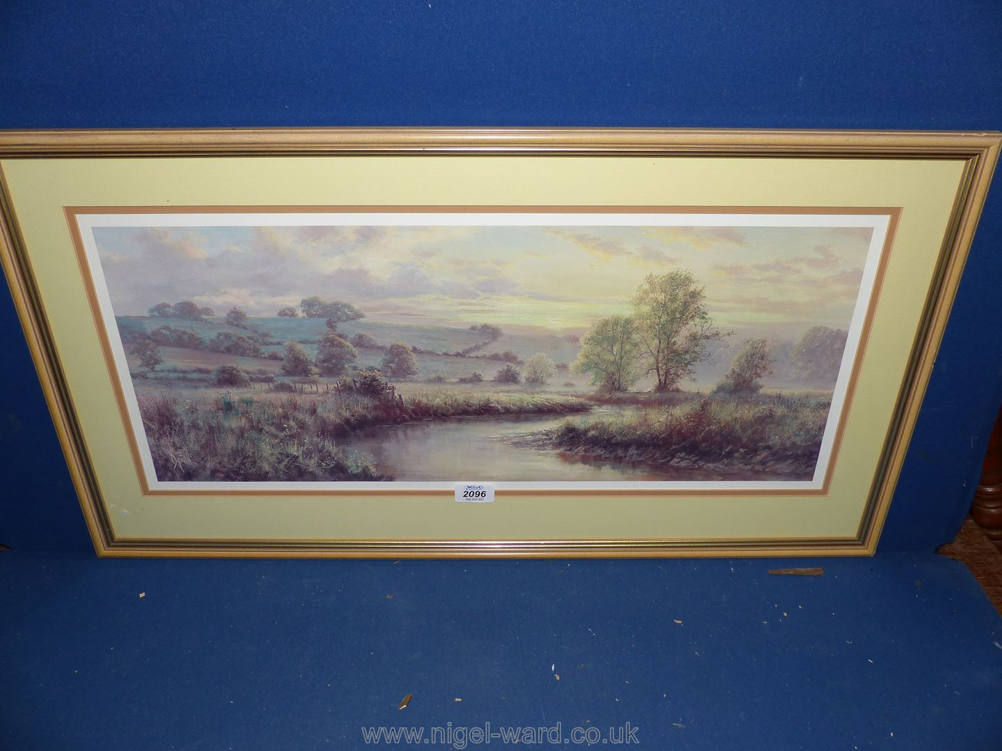 """A framed and mounted Print by David Dipnall, Landscape fields and stream, 31"""" x 16 1/2""""."""