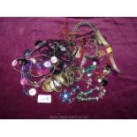 A quantity of costume jewellery including necklaces, earrings, etc.