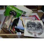 A quantity of 45 rpm records including Hot Chocolate, Gary Numan, Supertramp, etc.