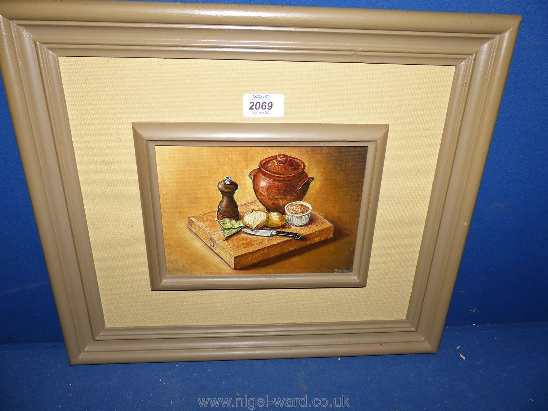 A framed J. Baxter Oil on board depicting a still life with lidded pot, pepper mill, onions etc.