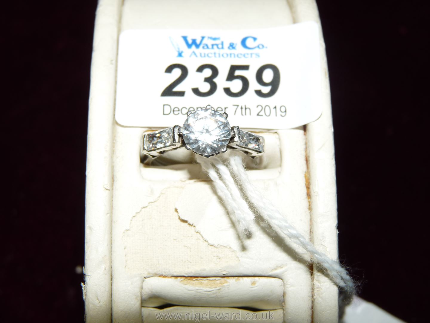 """A white gold Cubic Zirconia Ring set with three stones. Ring size """"P""""."""