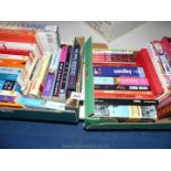 Two boxes of Japanese language and travel books and comic books.