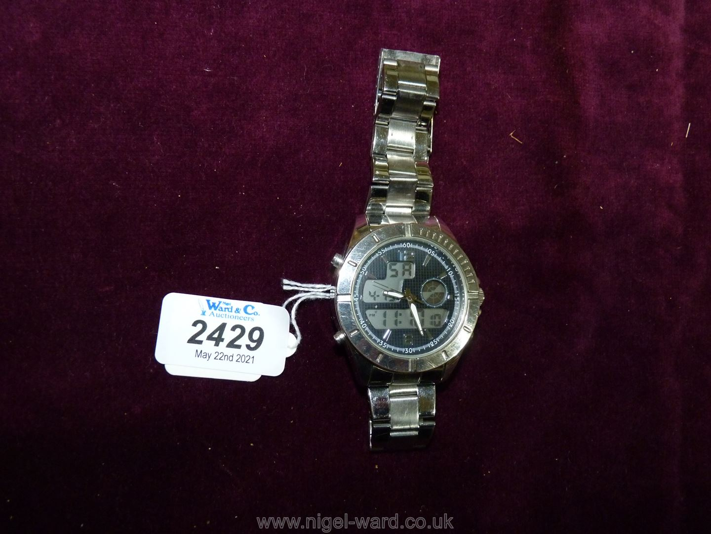 A heavy polished finish ''Executive Elite'' quartz movement Wristwatch having black grid pattern