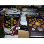 A box and bag of London Coins Auction catalogues, Baldwins, etc.