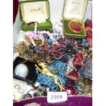 A quantity of costume jewellery including cuff links, necklaces, brooches etc.
