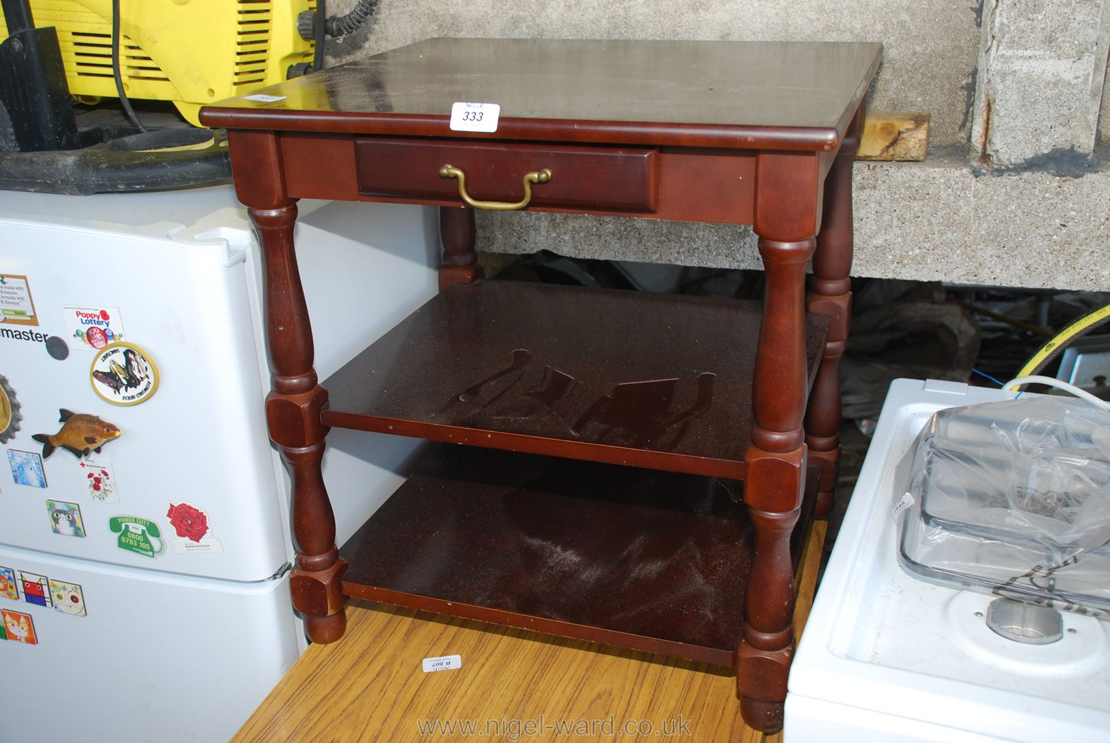 Occasional table with drawer and under shelves