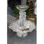 Concrete water feature with three semi nude maidens, on a column,