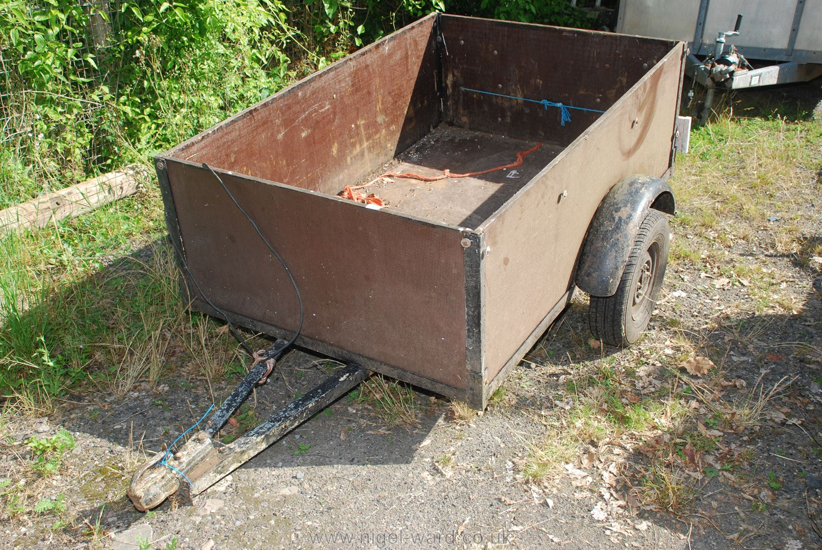 Small wooden trailer with tail board, 64'' x 42'' x 21'' high.