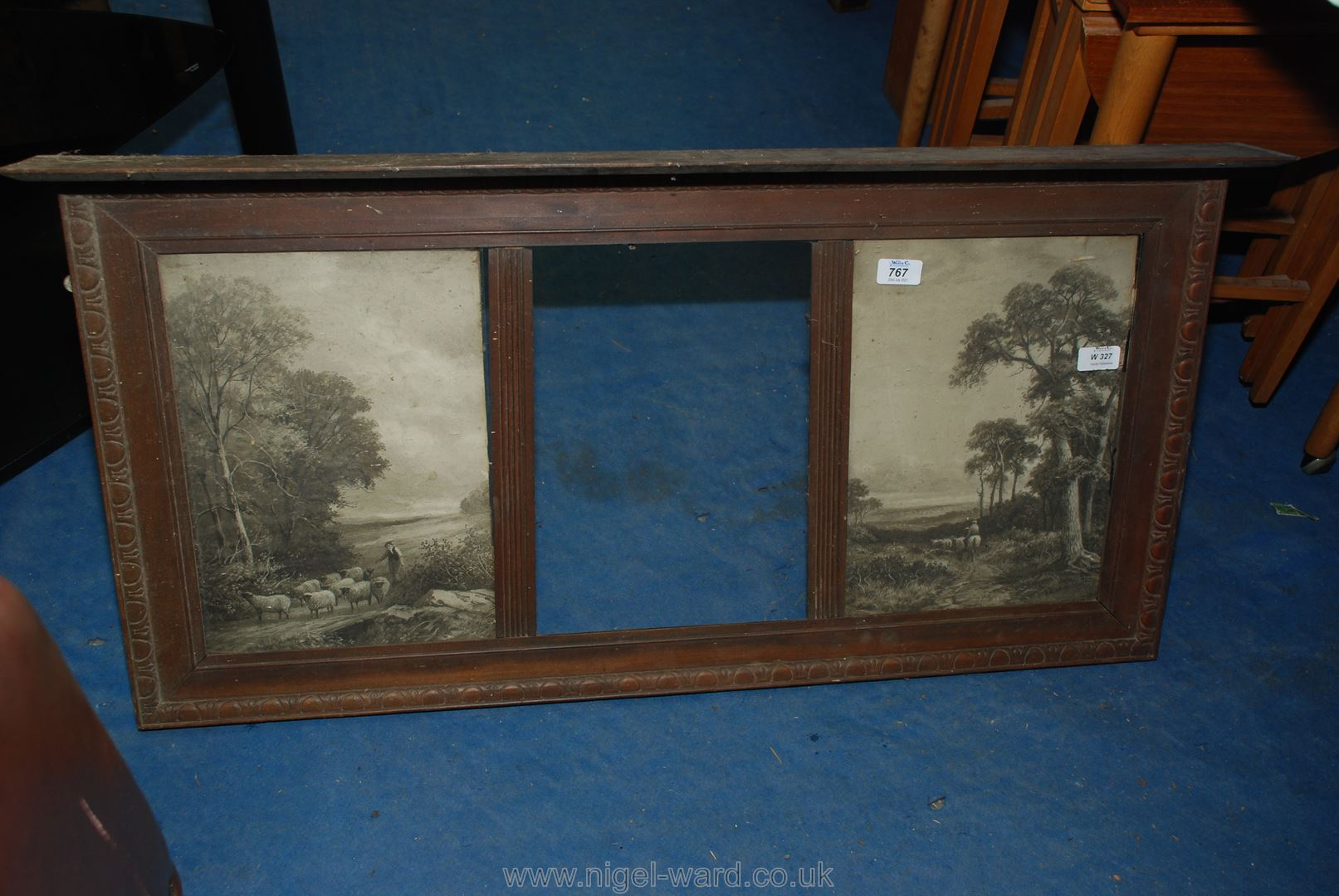 An Edwardian carved Oak overmantle incorporating two drover prints and space for central mirror.