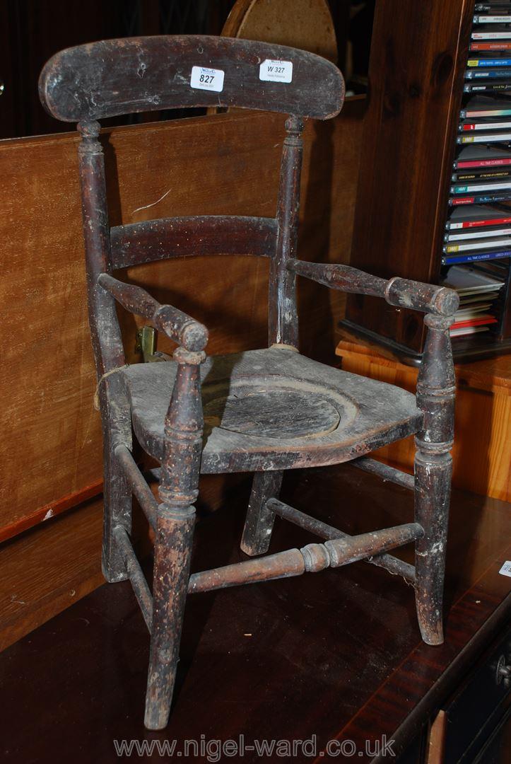 Child's potty chair in original finish.