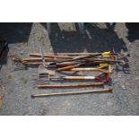 A quantity of garden tools including Wolf rake, hoe, walking sticks etc.