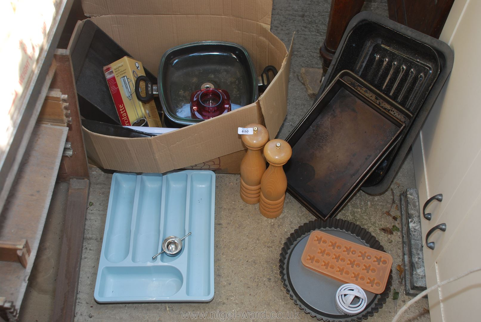 Box of kitchenware including flan dishes, cooking trays,
