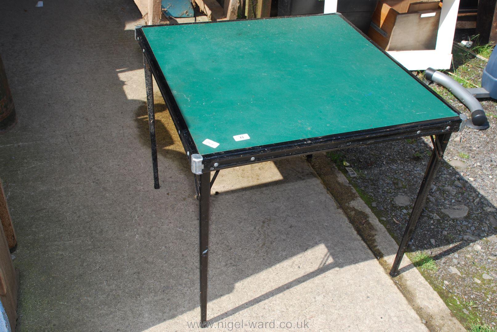 Metal framed and legged folding card table