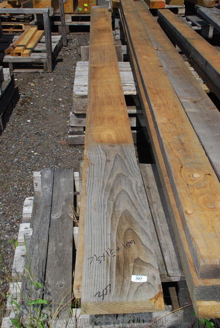 Three lengths of soft wood 7 1/2'' x 1 1/2'' x 189''.