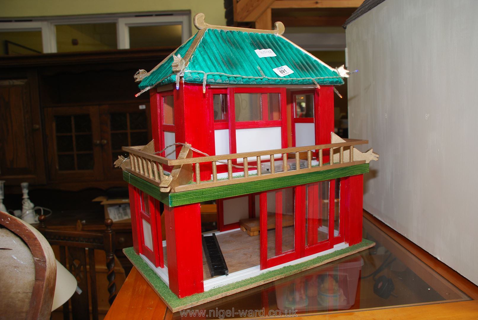 Japanese pagoda style house with battery fairy lights