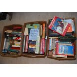 Three boxes of books including Jackie Collins,