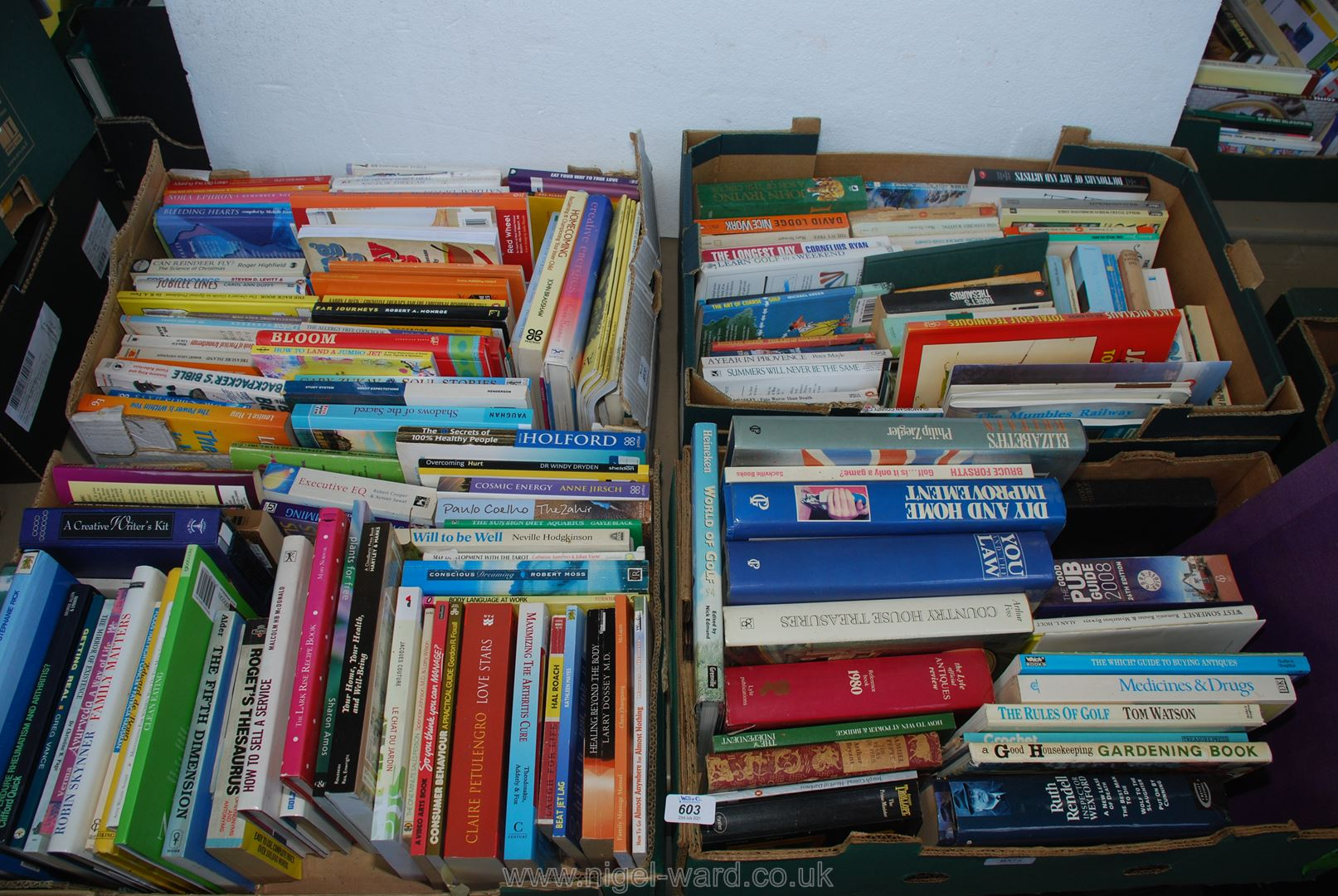 Four boxes of various books including golf etc