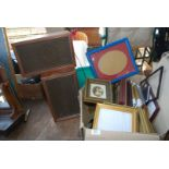 Two wooden Sony speakers and a large box of various picture frames, etc.