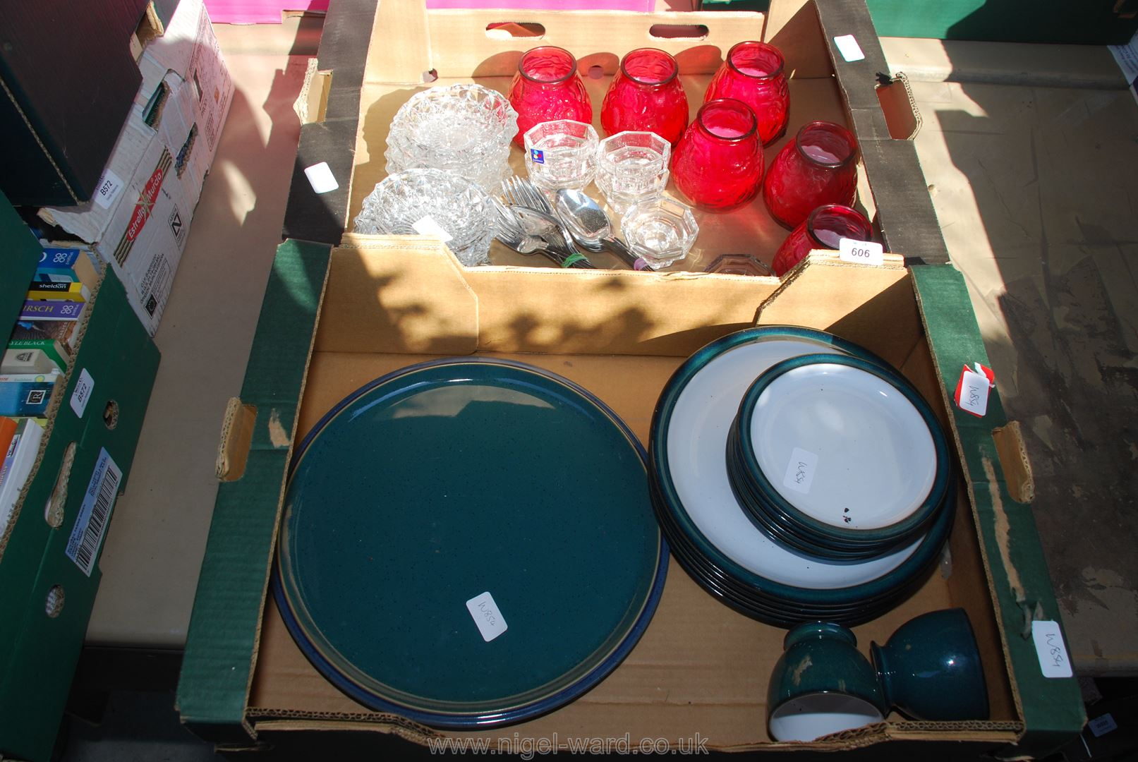 Two boxes of garden candles,