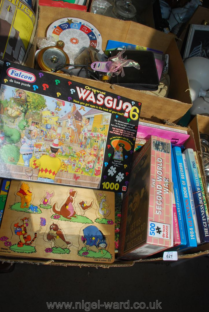 Box of jigsaws and box of miscellanea including Guiness Book of Records