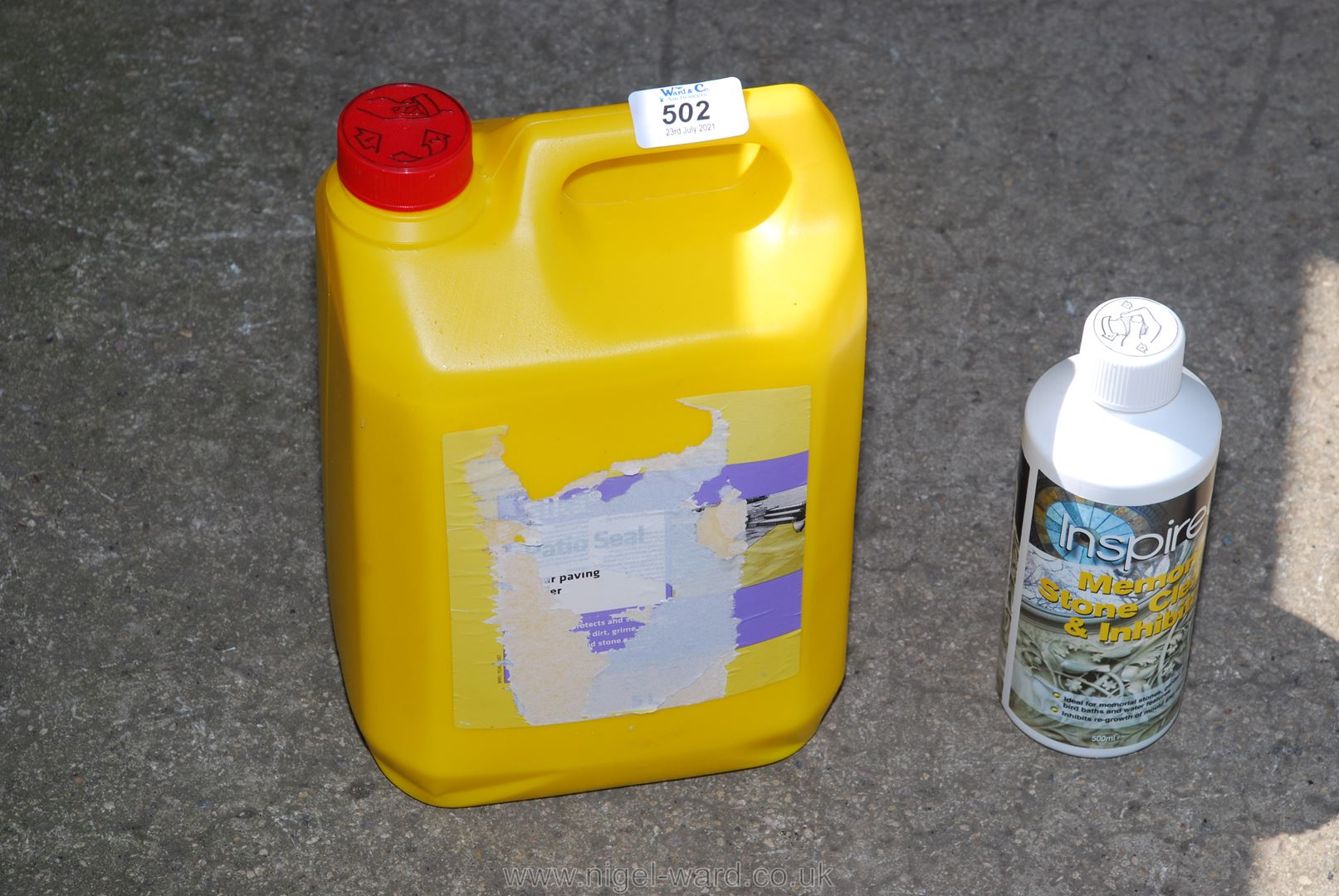 A container of patio sealer and memorial stone cleaner.