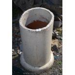 Painted terracotta drainage pipe used as stick stand