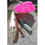 Two garden parasols, one with 'G' clamp and a folding canvas chair.