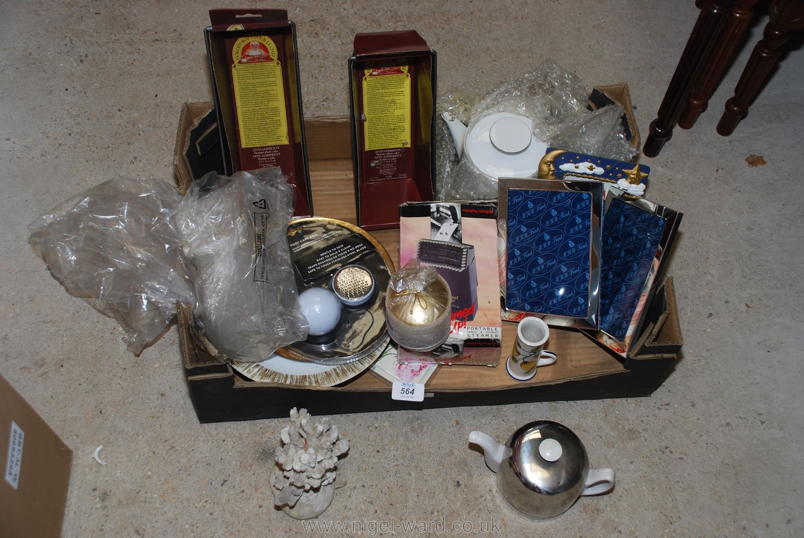 Box of miscellanea including loaf tins, coral,