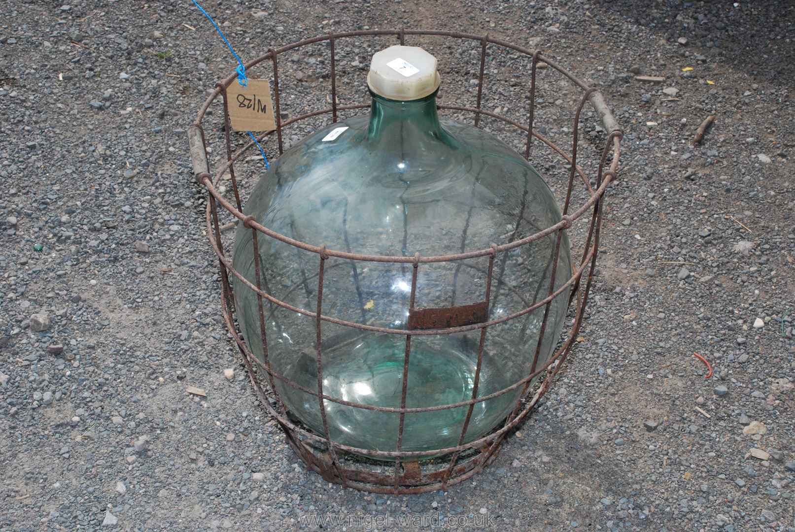 Clear glass Carboy in metal frame
