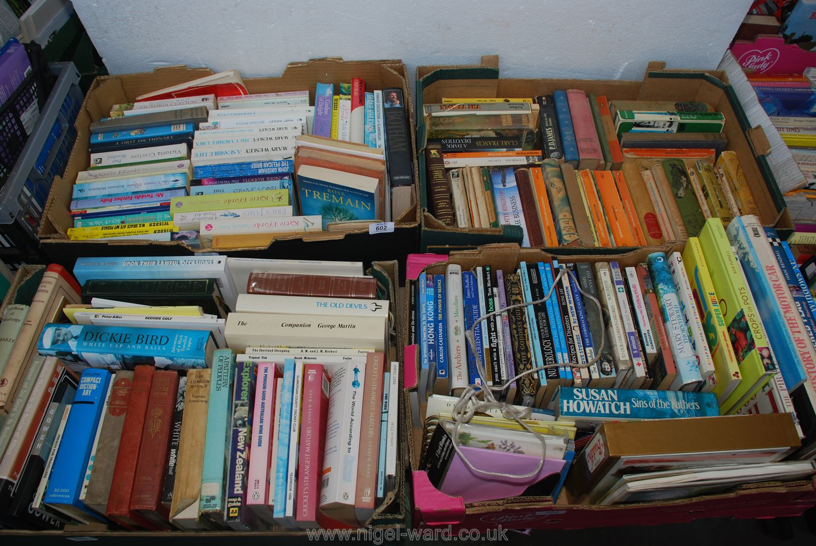 Four boxes of paperback books, cricket,