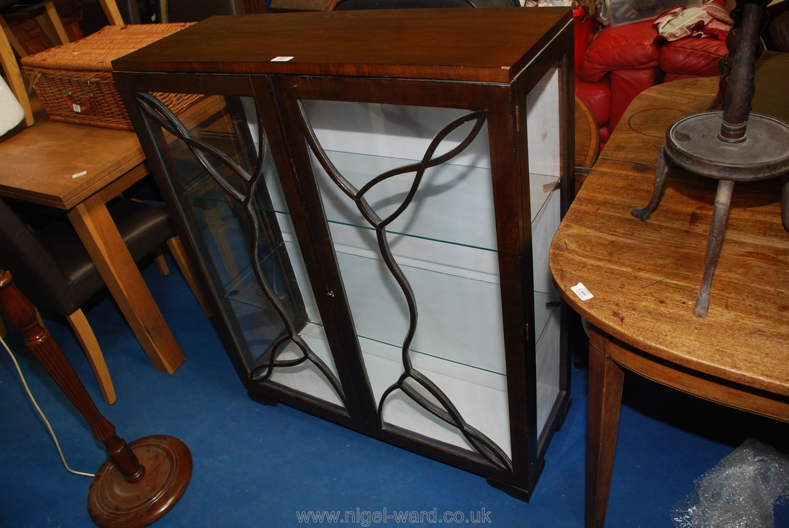 Glass fronted display cabinet with two shelves.