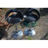 Pair of plastic seated and chrome bar stools
