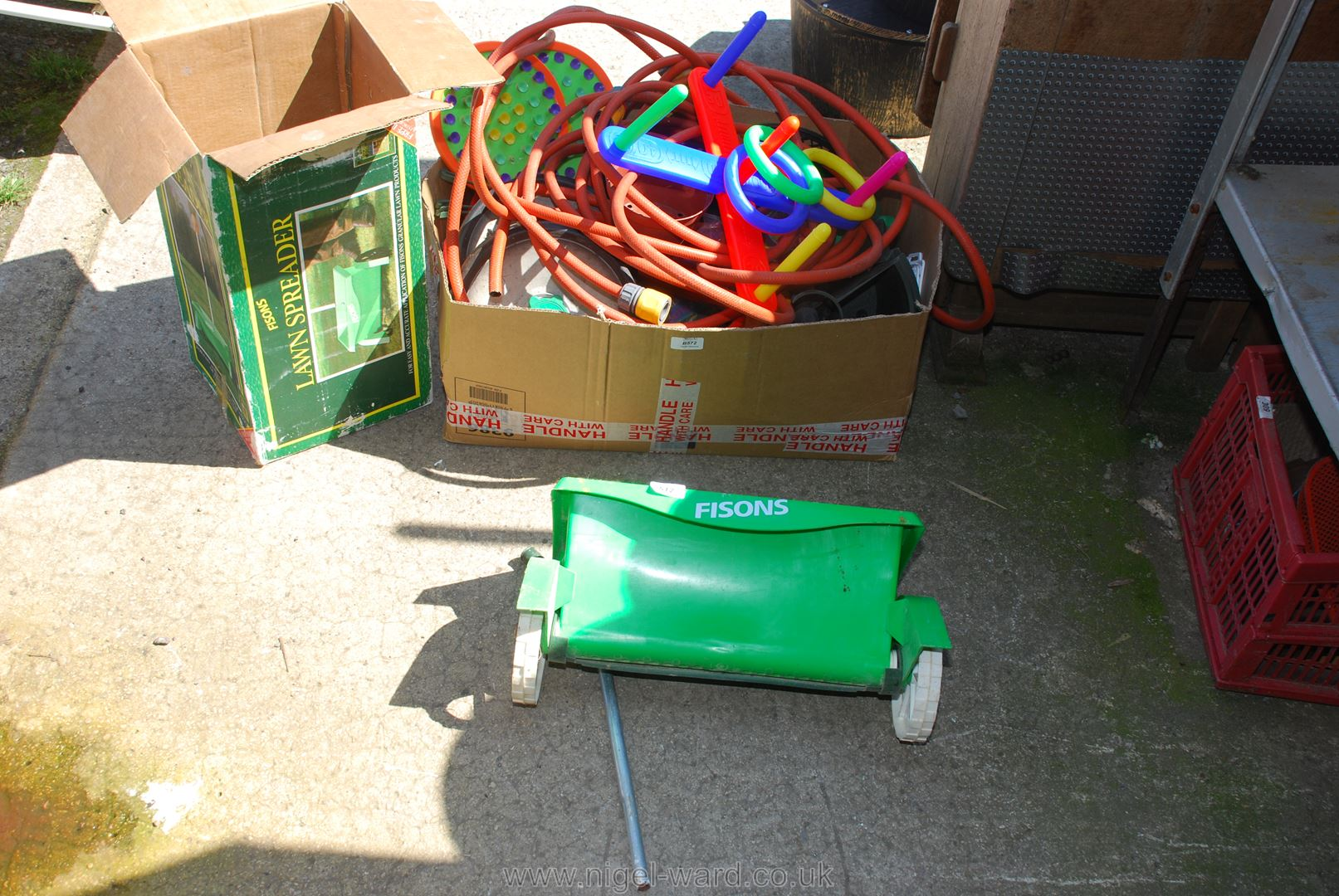 A quantity of garden hose, children's outside toys, hose lock fittings, lawn spreader, etc.