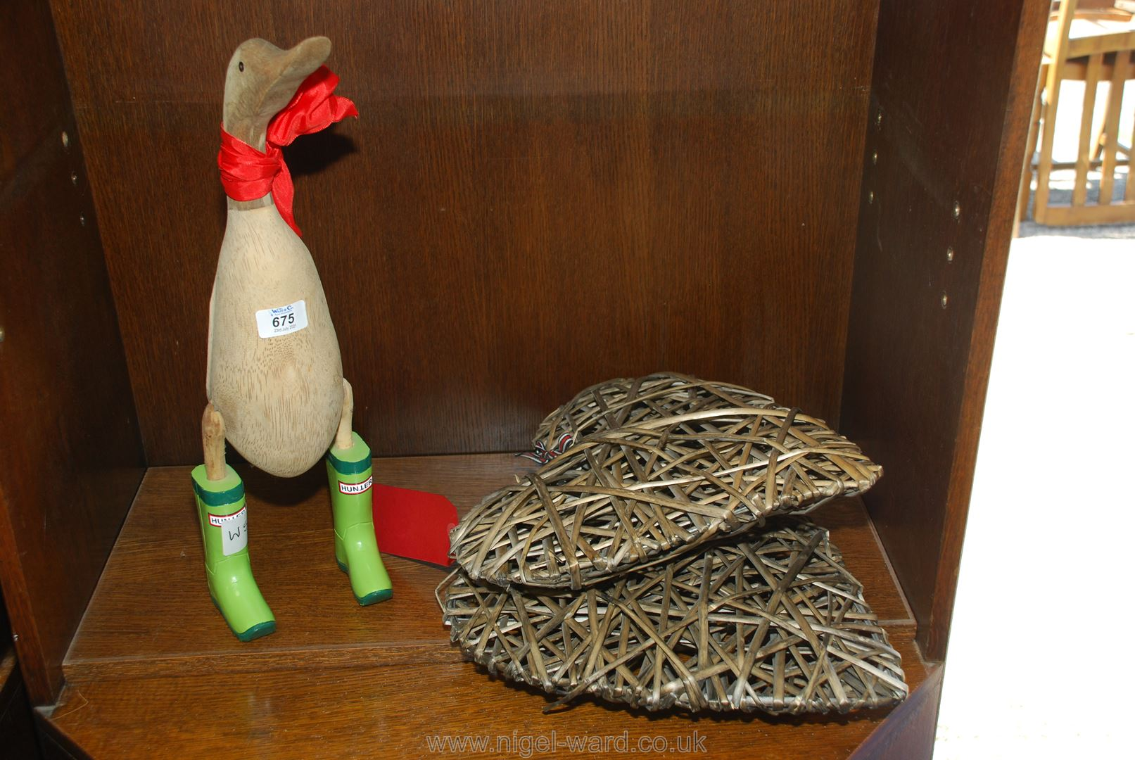 Wooden duck figure and two bamboo/willow hearts