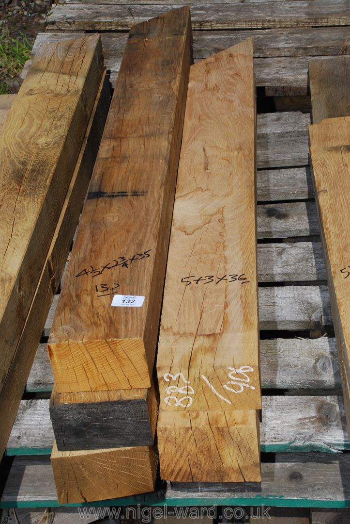 Five lengths of oak 3 @ 4 1/2'' x 2 2/3'' x 35'' and 2 @ 5'' x 3'' x 36''.