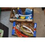 Box of various cleaning fluids and box of coat hangers