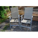 Pair of folding nylon seated deck chairs, (one arm a/f).