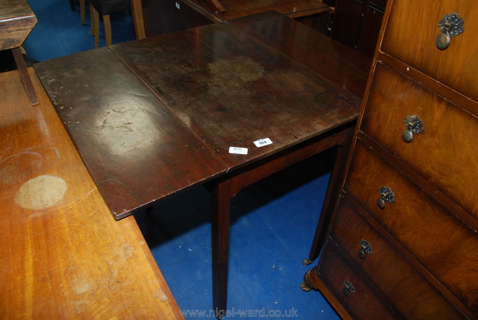 Drop leaf side table with one full depth drawer