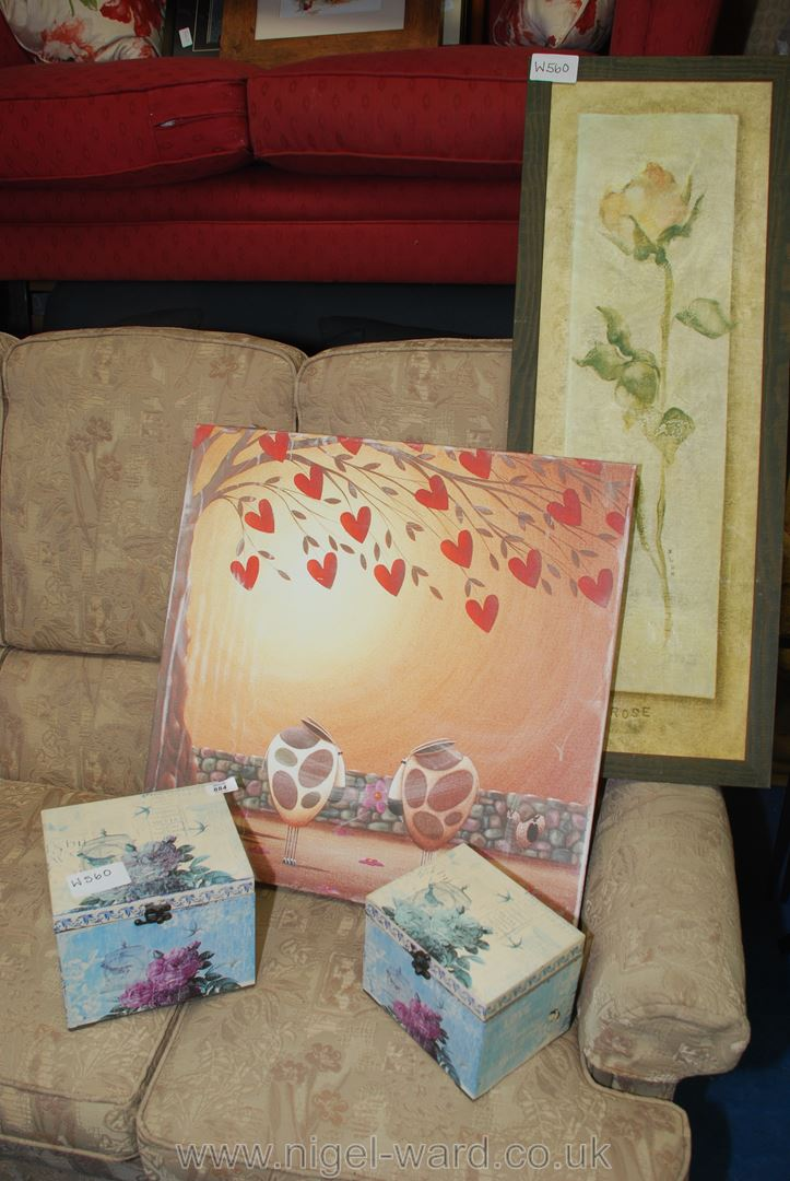 Print of stylised cows on canvas floral picture and stacking boxes