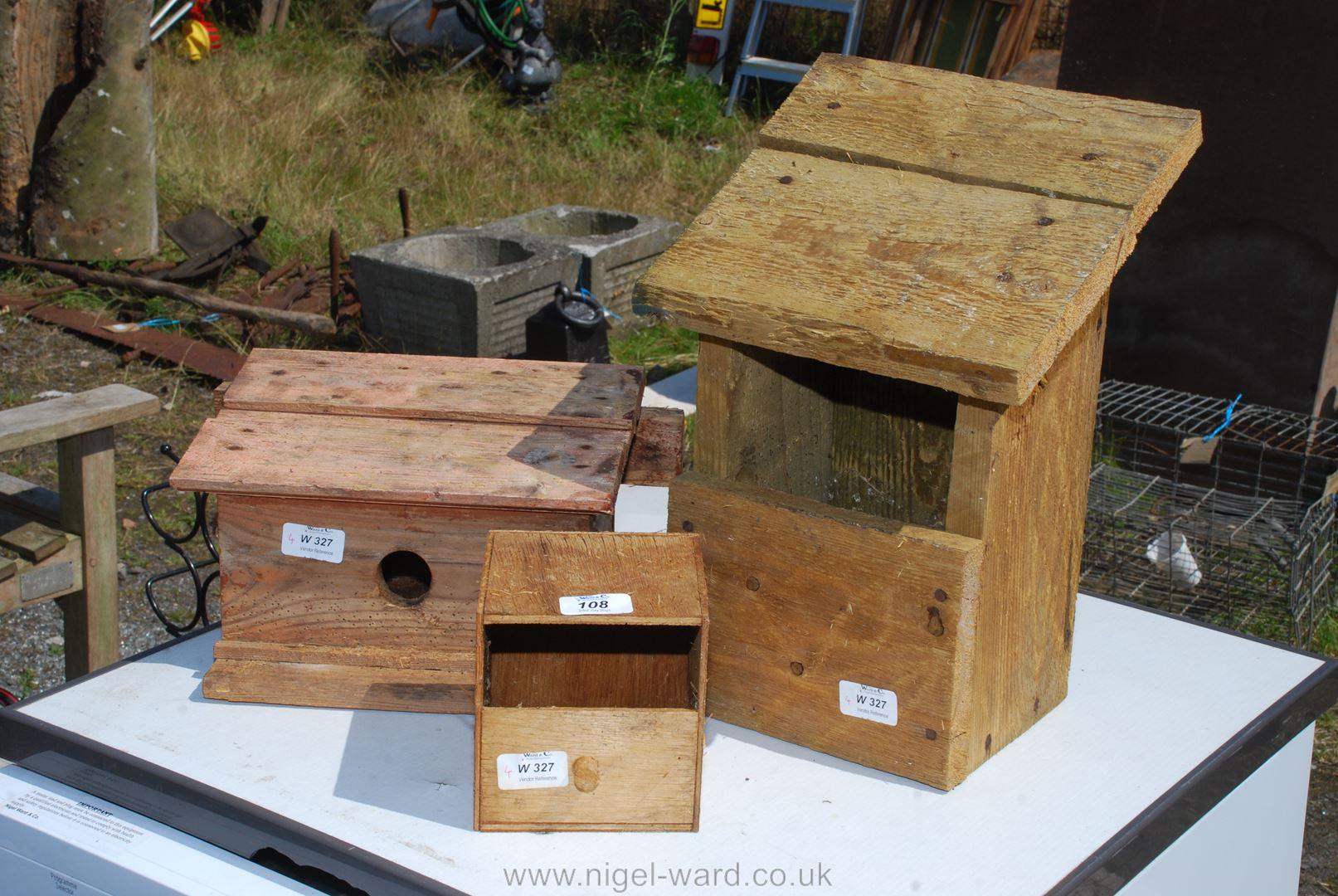 Three various wooden bird boxes.